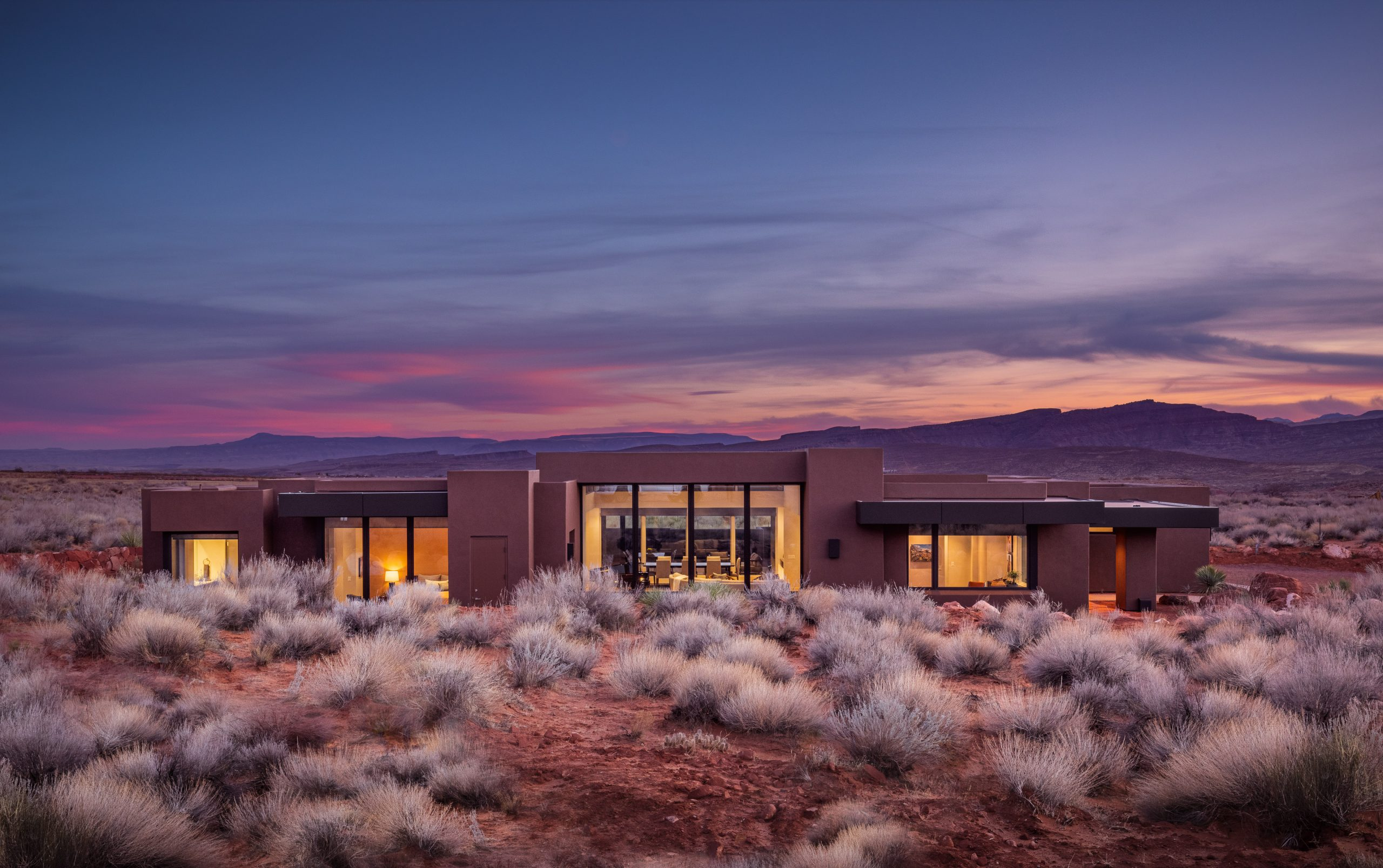 Kayenta Home Surrounded by Red Mountains